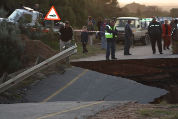 A gaping hole at the top end of the Sand River bridge