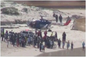 Photo of helicopter on Clovelly beach - about to airlift the shark victim to hospital today.