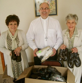 Church Secretary Jacqui MacKilligan, Rev Anthony Sutton and Ethel Schonevel with some of the shoes ready for distribution. Photo: Yvonne Craig