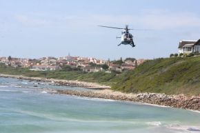 A SAP helicopter searches for the body of Simon Moses, 25 from Sea Vista who disappeared in the waves while swimming at Main Beach, St Francis Bay yesterday.