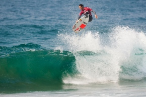 Image Caption: Jordy Smith (Durban, ZAF) punts a casual one handed aerial manuever to advance into the Round of 16 at the Mr Price Pro Ballito. © Mr Price / Cestari
