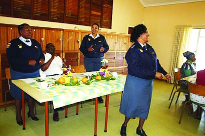 Captain Kiviet of the SAP station in St Francis Bay leads the women in singing and dancing at the high tea in St Francis Bay this morning.