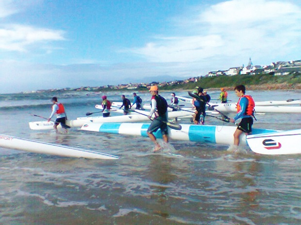Paddlers entering the sea at Main beach, St Francis Bay. Photo: Donna