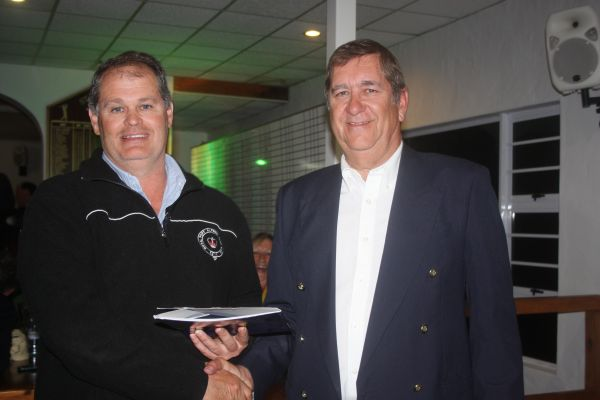 Golfer Anton Emslie receives his first prize of free air tickets to 'anywhere' from SFB GC club captain Ian Price.