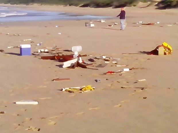Debris from Darren Hansen's yacht, Ingrid on the beach at Oyster Bay.