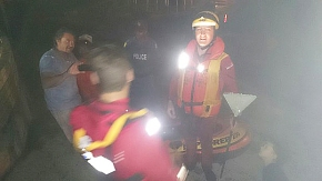 NSRI Bakoven crew holding the garden rake the 'mystery' man used as a paddle out at sea.